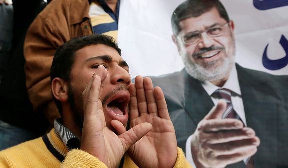 A supporter of Egyptian President Mohammed Morsi chants slogans during a demonstration outside the presidential palace in Cairo on Dec. 5, 2012. (Associated Press)