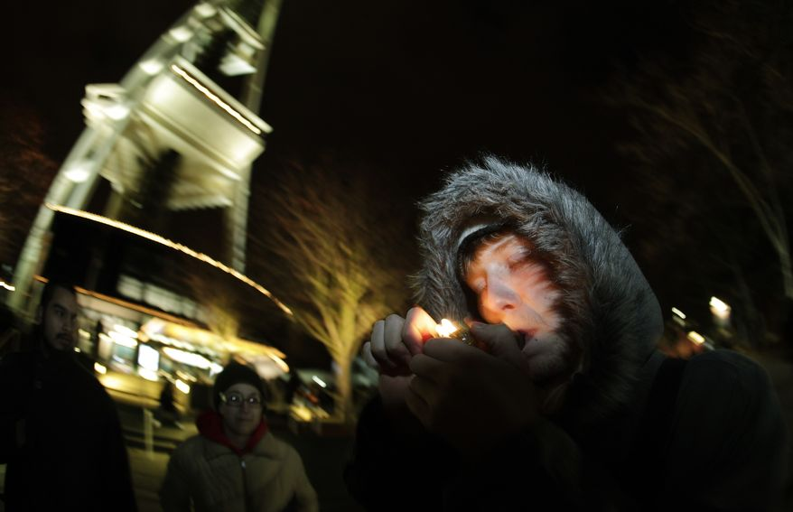 C. Nash smokes marijuana in a glass pipe on Thursday, Dec. 6, 2012, just after midnight at the Space Needle in Seattle, after the possession of marijuana became legal in Washington state. (AP Photo/Ted S. Warren)