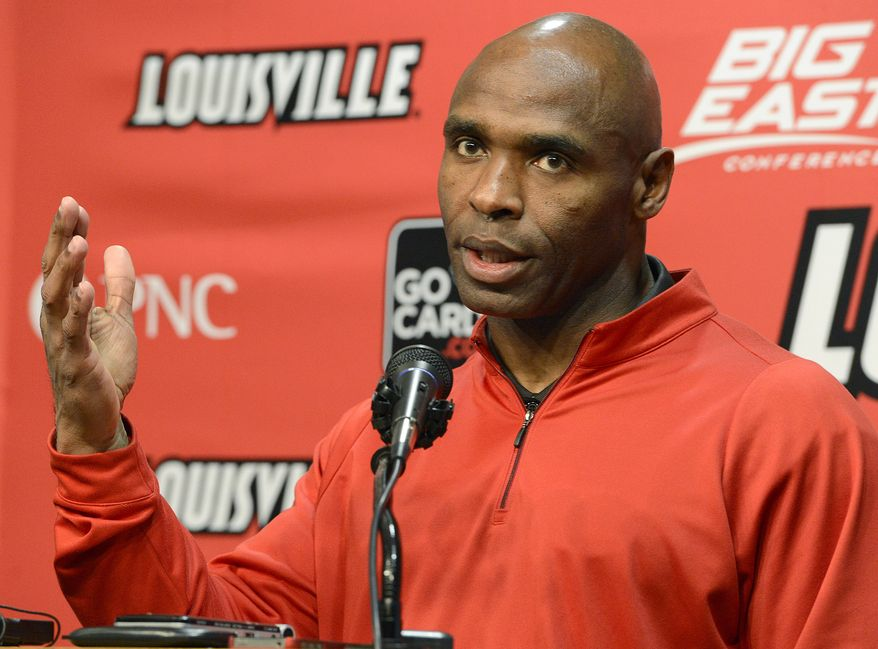 Louisville head football coach Charlie Strong addresses reporters during a news conference Thursday, Dec. 6, 2012, in Louisville, Ky. Strong turned down the job offer with the University of Tennessee to stay at Louisville.  (AP Photo/Timothy D. Easley)