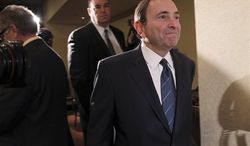 NHL commissioner Gary Bettman leaves the room after speaking to reporters after an NHL Board of Governors meeting, Wednesday, Dec. 5, 2012 in New York. The league and the NHL Players' Association have cleared their schedules with progress being made in collective bargaining talks. (AP Photo/Mary Altaffer)