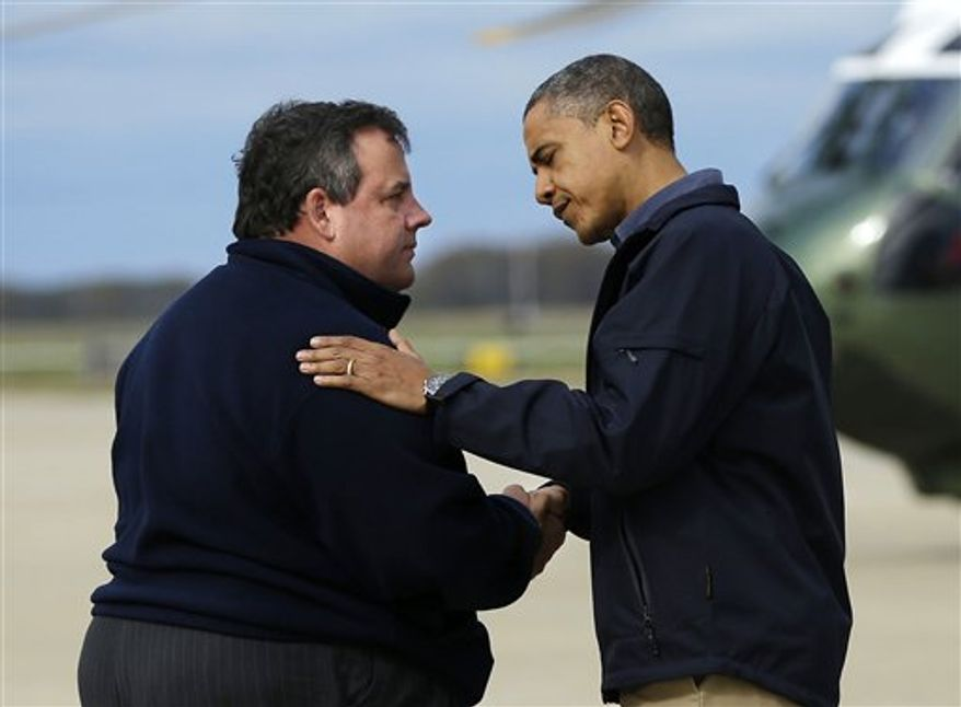 **FILE** President Obama is greeted Oct. 31, 2012, by New Jersey Gov. Chris Christie upon his arrival at Atlantic City International Airport in Atlantic City, N.J. Obama traveled to the region to take an aerial tour of the Atlantic Coast in New Jersey in areas damaged by superstorm Sandy. (Associated Press)