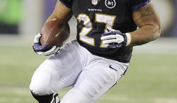 Baltimore Ravens running back Ray Rice carries the ball during the first half of an NFL football game against the Pittsburgh Steelers in Baltimore, Sunday, Dec. 2, 2012. (AP Photo/Nick Wass)