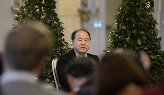 Mo Yan of China, the 2012 Nobel Literature Prize laureate speaks Dec. 6, 2012, during a press conference at the Royal Swedish Academy in Stockholm. The official prize giving ceremony takes place in Stockholm on Dec. 10. (Associated Press)