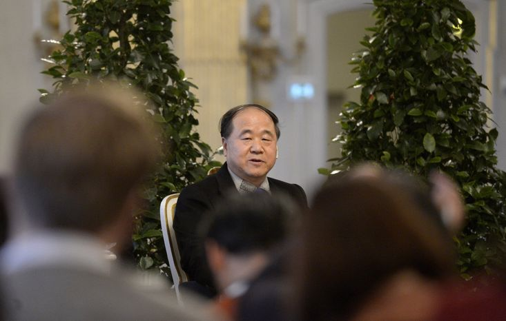 Mo Yan of China, the 2012 Nobel Literature Prize laureate speaks Dec. 6, 2012, during a press conference at the Royal Swedish Academy in Stockholm. The officia