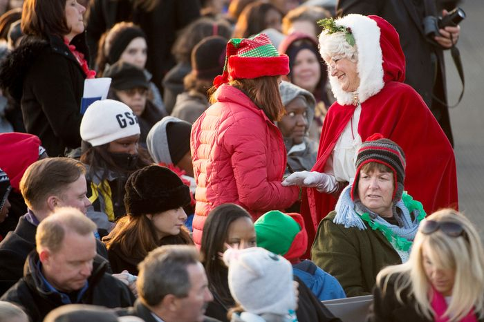 A festive crowd member arrives before President Obama and the first family light the National Christmas Tree on the Ellipse. (Andrew Harnik/The Washington Times)