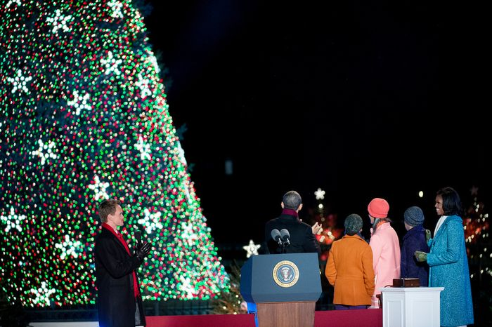 President Obama and the first family admire the National Christmas Tree after it was lit.  Neil Patrick Harris claps at left. (Andrew Harnik/The Washington Times)