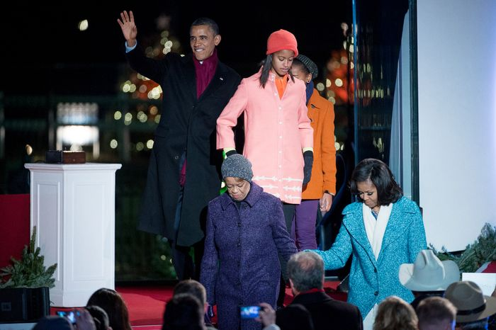 President Obama and the first family take their seats after lighting the National Christmas Tree on the Ellipse. (Andrew Harnik/The Washington Times)