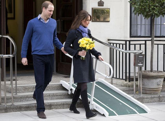 **FILE** Britain's Prince William stand next to his wife Kate, Duchess of Cambridge, as she leaves the King Edward VII hospital in central London on Dec. 6, 2012. They are expecting their first child, and the Duchess was admitted to hospital suffering from a severe form of morning sickness in the early stages of her pregnancy. (Associated Press)