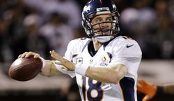 Denver Broncos quarterback Peyton Manning attempts a pass against the Oakland Raiders during the second quarter of the Broncos' 26-13 victory in Oakland, Calif., on Dec. 6, 2012. (Associated Press)