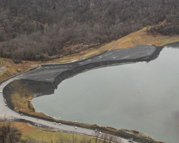 This photo from Dec. 3, 2012, provided by the West Virginia Department of Environmental Protection, shows the embankment after a collapse at the Consol's Robinson Run operation in Harrison County, W.Va. Crews continued to look for a missing miner and bulldozer that slid into the impoundment with two trucks and two engineers when an embankment under construction internal to the impoundment collapsed about noon on Nov. 30. (Associated Press/W.Va. Department of Environmental Protection)