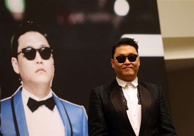 """South Korean rapper Psy, who gained popularity with his song """"Gangnam Style,"""" gives a press conference before a concert at the Marina Bay Sands in Singapore on Saturday, Dec. 1, 2012. (AP Ph"""