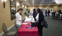 A person fills out an application at the Fort Lauderdale Career Fair in Dania Beach, Fla., on Nov. 30, 2012. (Associated Press)