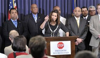 """** FILE ** Senate Minority leader Gretchen Whitmer, D-East Lansing, speaks to supporters Wednesday afternoon, Dec. 5, 2012 at the Capitol in Lansing, Mich., on """"Right To Work"""" legislation. (AP Photo/The Detroit News, Dale G. Young)"""