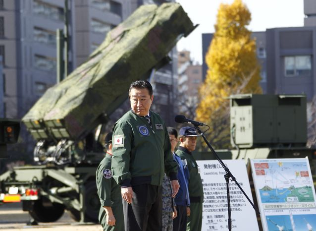 Japanese Prime Minister Yoshihiko Noda, standing by a ground-based Patriot Advanced Capability-3 interceptor, looks back as he speaks during his inspection tour to the Defense Ministry in Tokyo on Dec. 7, 2012. Japan deployed the PAC-3 system on the ministry compound in the middle of Tokyo to prepare for North Korea's planned launch of a long-range rocket starting Dec. 10. (Associated Press)
