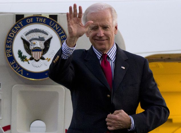 **FILE** Vice President Joseph R. Biden Jr. waves as he arrives to Benito Juarez International airport in Mexico City on Nov. 30, 2012. (Associated Press)