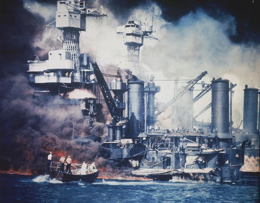 **FILE** In this U.S. Navy photo, a small boat rescues a USS West Virginia crew member from the water after the Japanese bombing of Pearl Harbor, Hawaii, on Dec. 7, 1941, during World War II. Two men (upper center) can be seen on the superstructure. The mast of the USS Tennessee is beyond the burning West Virginia. On Dec. 7, 1941, Japanese Imperial Navy navigator Takeshi Maeda guided his Kate bomber to Pearl Harbor and fired a torpedo that helped sink the USS West Virginia. (Associated Press)