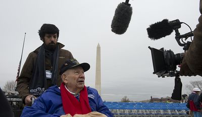 Harry Patch, who served in the Pacific with the U.S. Navy during World War II, is interviewed at the World War II Memorial in Washington, D.C. on Friday, Dec. 7, 2012 before a National Pearl Harbor Remembrance Day ceremony. Vipul Tripathi with Reingold communications accompanied Mr. Patch, who was one of several veterans who came for the ceremony. (Barbara L. Salisbury/The Washington Times)