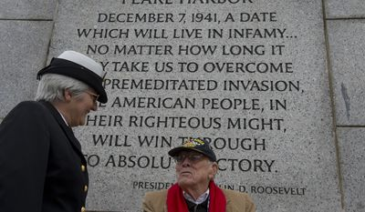 CSC Marsha Stepp, left, U.S. Navy Reserves, talks with Olaf Miller of McLean, Va., who served with the U.S. Army at what was then Fort Hoyl but is now part of Aberdeen in 1942. Mr. Miller was one of several World War II veterans who came out to the National World War II Memorial in Washington, D.C. on Friday, Dec. 7, 2012 for National Pearl Harbor Remembrance Day. (Barbara L. Salisbury/The Washington Times)