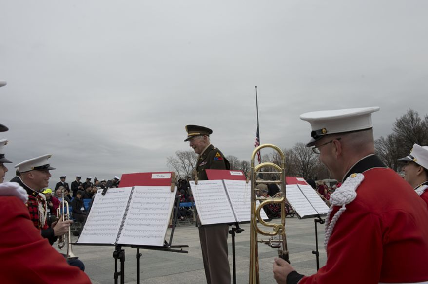 A veteran comes up to chat with the Marine Band brass quintet before the National Pearl Harbor Remembrance Day ceremony at the National World War II Memorial on Friday, Dec. 7, 2012. (Barbara L. Salisbury/The Washington Times)