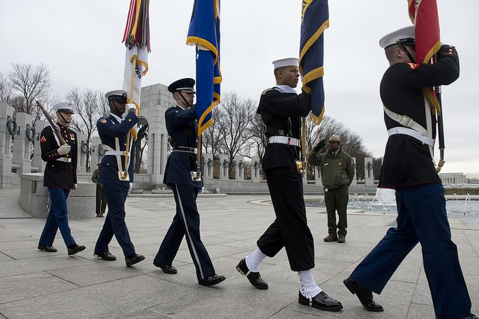 A U.S. Park Police officer salutes as the United States Armed Forces Color Guard presents the colors at the National Pearl Harbor Remembrance Day ceremony Friday, Dec. 7, 2012 at the National World War II Memorial in Washington, D.C. (Barbara L. Salisbury/The Washington Times)