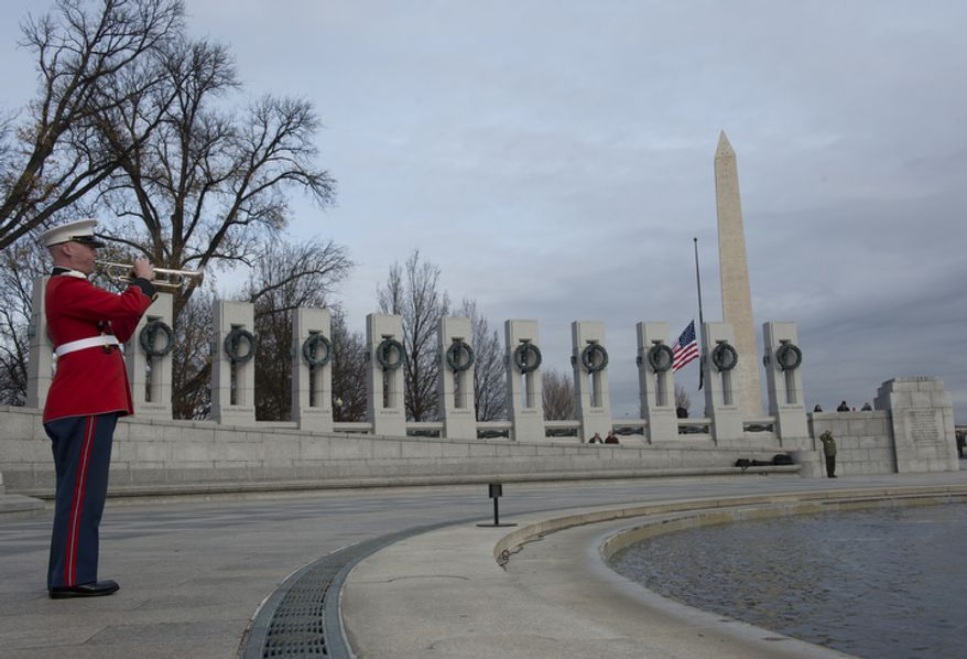 "A U.S. Marine plays ""Taps"" at the end of the National Pearl Harbor Remembrance Day ceremony on Friday, Dec. 7, 2012 at the National World War II Memorial in Washington, D.C. This marks the 71st anniversary of the attack on Pearl Harbor. (Barbara L. Salisbury/The Washington Times)"