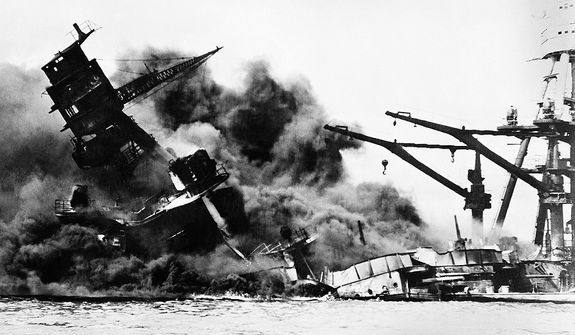 """The battleship USS Arizona belches smoke as it topples over into the sea during Japanese surprise attack on Pearl Harbor, Hawaii, December 7, 1941. The ship sank with more than 80 percent of its 1,500-man crew, including Rear Admiral Issac C. Kidd. The attack, which left 2,343 Americans dead and 916 missing, broke the backbone of the U.S. Pacific Fleet and forced America out of a policy of isolationism. President Franklin D. Roosvelt announced that it was """"a date which will live in infamy"""" and Congress declared war on Japan the morning after. This was the first attack on American territory since 1812. (AP Photo)"""