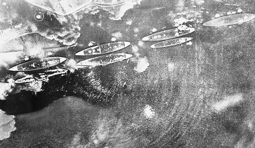 "This Japanese navy air view of smoking U.S. ships during Pearl Harbor attack appeared in a 1942  publication called ""The New Order in Greater East Asia,"" a copy of which has just become available, Oct. 14, 1945 in New York. (AP Photo)"