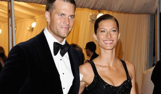 **FILE** New England Patriots QB Tom Brady and his wife, supermodel Gisele Bundchen, attend at the Metropolitan Museum of Art Costume Institute gala benefit in New York on May 7, 2012. (Associated Press)