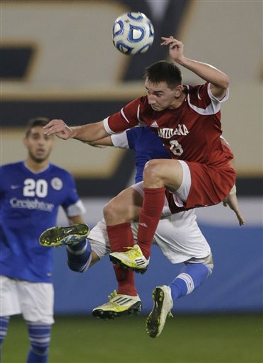 Indiana's Nikita Kotlov (8) battles for the ball with Creighton's Bruno Castro, rear, as Christian Blandon (20) watches in the second half of a NCAA College Cup men's championship semifinal soccer match at Regions Park, Friday, Dec. 7, 2012, in Hoover, Ala. Indiana won 1-0. (AP Photo/Dave Martin)
