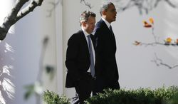 "President Obama (right) walks with Treasury Secretary Timothy F. Geithner toward the Oval Office at the White House in Washington as he returns from speaking about the ""fiscal cliff"" at the Business Roundtable, an association of chief executive officers, on Wednesday, Dec. 5, 2012. (AP Photo/Charles Dharapak)"