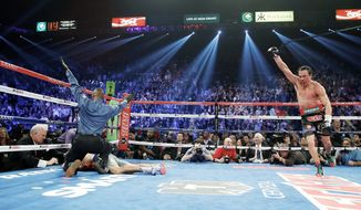 associated press  Referee Kenny Bayless calls the fight Saturday as Juan Manuel Marquez celebrates after knocking out Manny Pacquiao at the MGM Grand Garden Arena in Las Vegas.