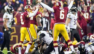 Redskins kicker Kai Forbath (2) celebrates with holder Sav Rocca after converting the winning 34-yard field goal in overtime against the Ravens on Sunday. (Craig Bisacre/The Washington Times)