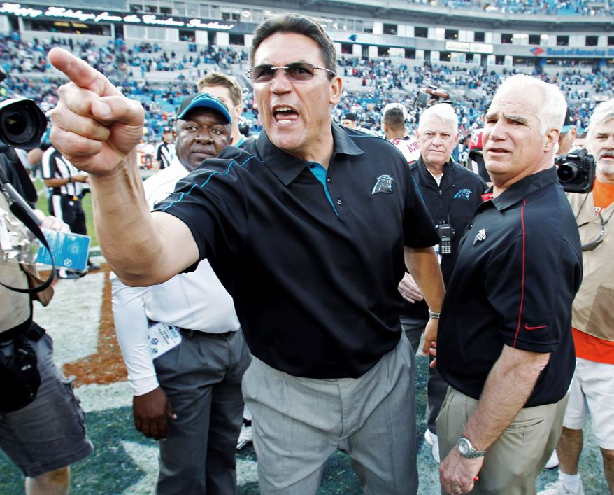associated press Panthers coach Ron Rivera shouts while Falcons head coach Mike Smith looks on Sunday after Carolina defeated its NFC South rival 30-20.