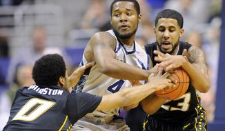 Towson guard Jerome Hairston (0) and Mike Burwell (23) battle for the ball against Georgetown guard D'Vauntes Smith-Rivera (4) during the first half of an NCAA college basketball game, Saturday, Dec. 8, 2012, in Washington. (AP Photo/Nick Wass)