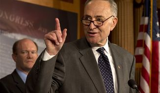 """Sen. Charles Schumer, New York Democrat, accompanied by Sen. Chris Coons, Delaware Democrat, gestures during a news conference on Capitol Hill, Thursday, Dec. 6, 2012, to discuss efforts to """"boost the economy and prevent Americans from abruptly losing their jobless benefits at the end of the year."""" (AP Photo/Jacquelyn Martin)"""