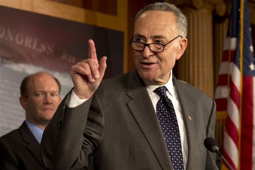 "Sen. Charles Schumer, New York Democrat, accompanied by Sen. Chris Coons, Delaware Democrat, gestures during a news conference on Capitol Hill, Thursday, Dec. 6, 2012, to discuss efforts to ""boost the economy and prevent Americans from abruptly losing their jobless benefits at the end of the year."" (AP Photo/Jacquelyn Martin)"