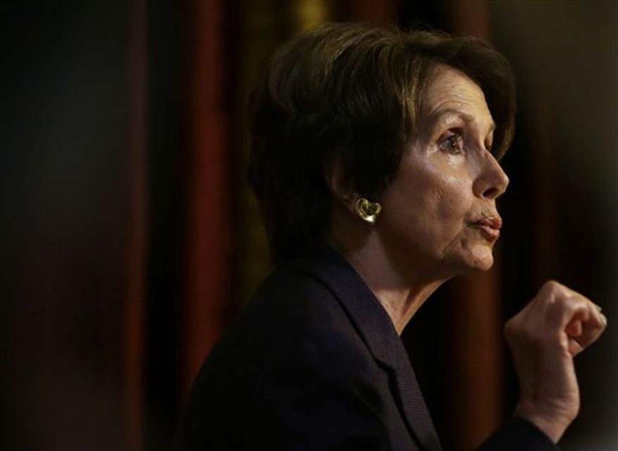 House Minority Leader Nancy Pelosi of California gestures as she speaks to reporters at Statuary Hall on Capitol Hill, Friday, Dec. 7, 2012. (AP Photo/Pablo Martinez Monsivais)