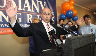 **FILE** Rep. Charles W. Boustany Jr. reacts after receiving news of his election win to Louisiana's 3rd Congressional District seat while his wife, Bridget, and family Ashley, Jacques, Caree and Erik look on, on Dec. 8, 2012, in Lafayette, La. (Associated Press/The Advertiser)