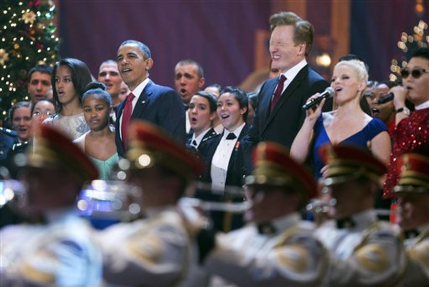 President Obama, third from left, with his daughters Malia Obama, from left, and Sasha Obama, join host, from third right to right, Conan O'Brien, singer Megan Hilty, South Korean rapper Psy and other performers, during the Annual Christmas in Washington presentation at the National Building Museum in Washington, Sunday, Dec. 9, 2012. (AP Photo/Manuel Balce Ceneta)