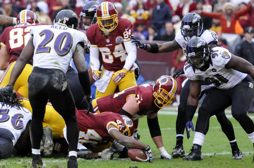 Washington Redskins running back Alfred Morris (46) reaches the ball across the goal line for a first-quarter touchdown against the Raven's at FedEx Field, Landover, Md., Dec. 9, 2012. (Preston Keres/Special to The Washington Times)