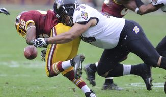 Baltimore Ravens nose tackle Ma'ake Kemoeatu (96) forces Washington Redskins running back Alfred Morris (46) to fumble in the second quarter at FedEx Field, Landover, Md., Dec. 9, 2012. (Preston Keres/Special to The Washington Times)