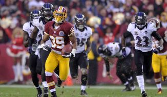 Washington Redskins cornerback Richard Crawford (39) returns an overtime punt 64 yards to the Baltimore 24 yard line at FedEx Field, Landover, Md., Dec. 9, 2012. (Preston Keres/Special to The Washington Times)
