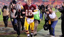 Washington Redskins quarterback Kirk Cousins (12) leaves the field with a thumbs up after leading the Redskins to a 31-28 overtime victory over the Baltimore Ravens at FedEx Field, Landover, Md., Dec. 9, 2012. (Preston Keres/Special to The Washington Times)