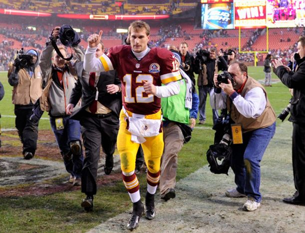 Washington Redskins quarterback Kirk Cousins (12) leaves the field with a thumbs up after leading the Redskins to a 31-28 overtime victory over the Baltimore Ravens