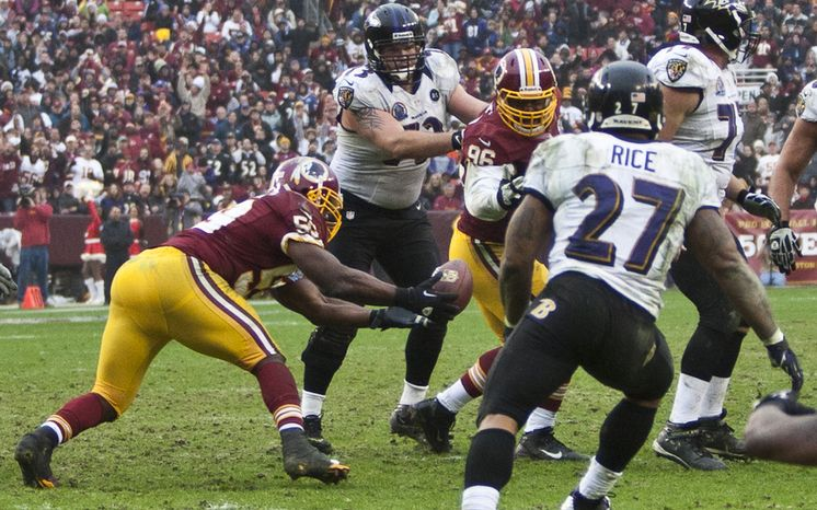 Washington Redskins inside linebacker London Fletcher (59) intercepts Baltimore Ravens quarterback Joe Flacco (5) pass in the second half at FedEx Field in Landover Md., on Sunday, December 9, 2012. Washington Redskins won 31 to 28. (Craig Bisacre/The Washington Times)