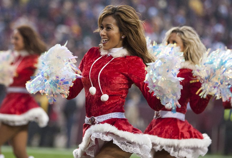 Washington Redskins cheerleaders performs in holiday attire during the second half at FedEx Field in Landover Md., on Sunday, December 9, 2012. Washington Redskins won 31 to 28. (Craig Bisacre/The Washington Times)