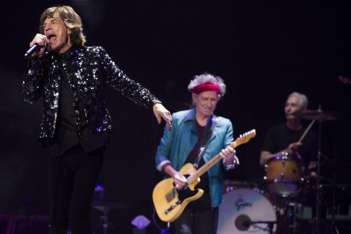 Mick Jagger (from left), Keith Richards and Charlie Watts of the Rolling Stones perform in concert on Saturday, Dec. 8, 2012, in th