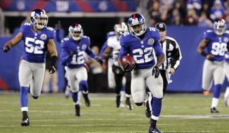 New York Giants running back David Wilson (22) returns a kickoff 97 yards for a touchdown against the New Orleans Saints during the first quarter of their NFL football game, Sunday, Dec. 6, 2012, in East Rutherford, N.J. Giants' Spencer Paysinger (52), Jerrel Jernigan (12) and Adrian Tracy (98) follow the play. The Giants won 52-27. (AP Photo/The Record of Bergen County, Chris Pedota) ONLINE OUT; MAGS OUT; TV OUT; INTERNET OUT;  NO ARCHIVING; MANDATORY CREDIT