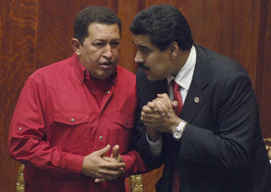 ** FILE ** Venezuelan President Hugo Chavez (left) talks with then-Foreign Minister Nicolas Maduro at the University of Uruguay in Montevideo, Uruguay, in December 2007. (AP Photo/Matilde Campodonico)