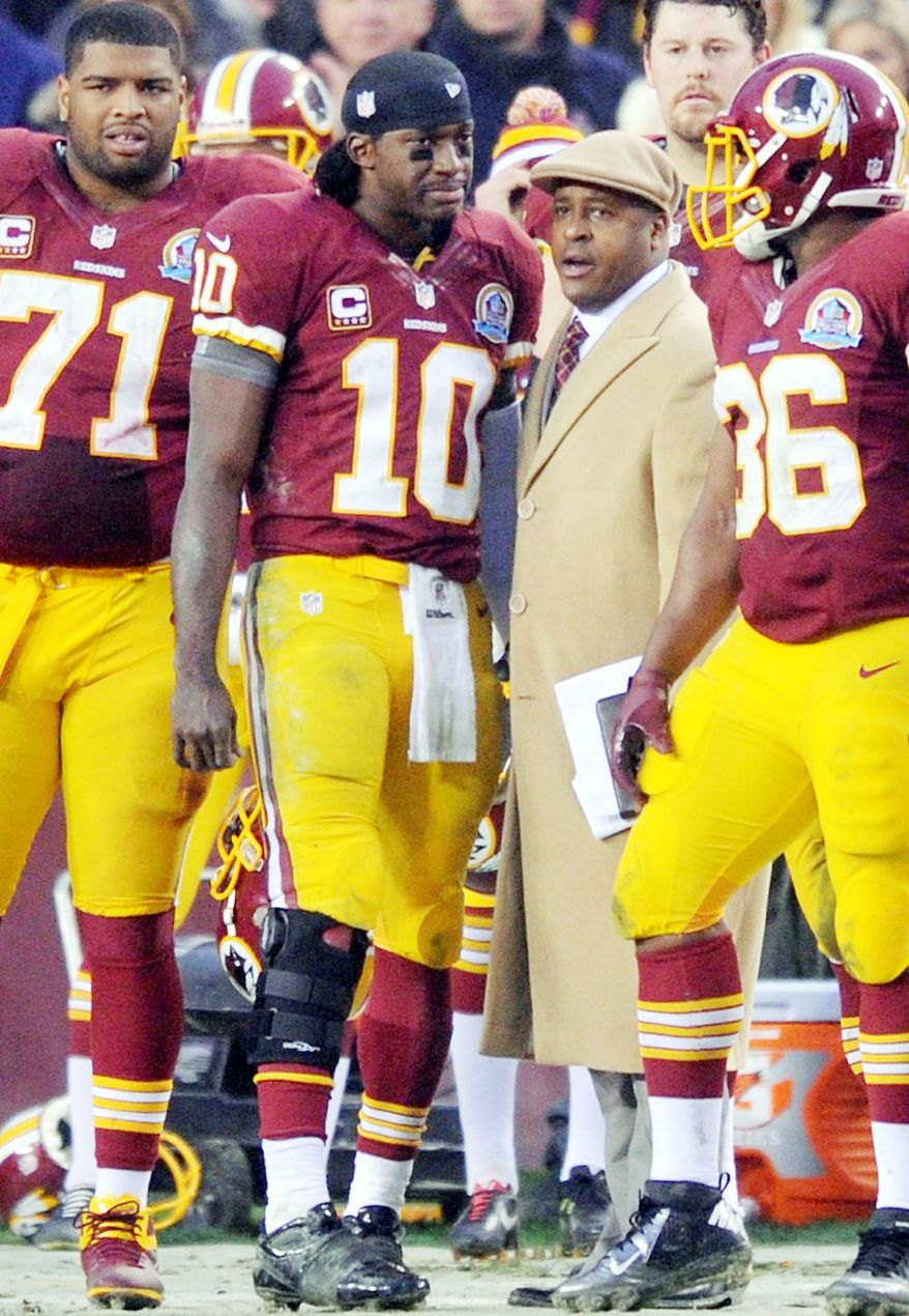 Quarterback Robert Griffin III has been knocked out of two games, on Oct. 7 with a concussion and Sunday with a sprained knee ligament. (Preston Keres/Special to The Washington Times)